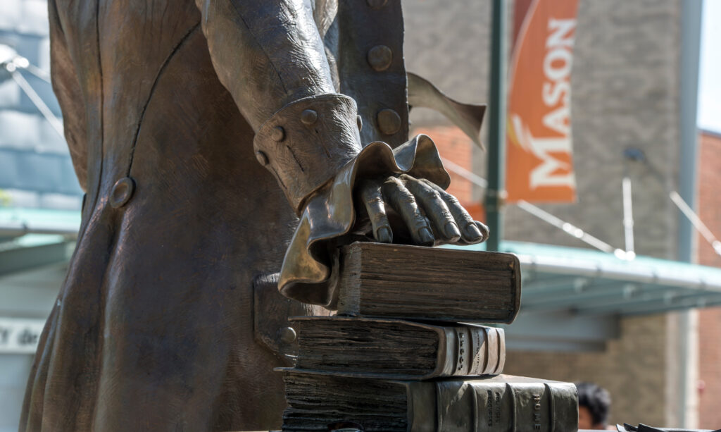 Detail of the Mason Statue on the North Plaza at the Fairfax Campus.