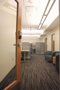 View into Mason Publishing Office, showing chairs and reception desk.